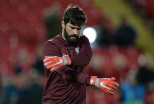 Alisson warms up